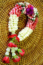 Thai style garland beautiful fresh flower on woven wood background Stock Photography