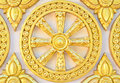 Thai style golden molding wheel of life pattern Royalty Free Stock Photo
