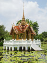 Thai style golden pavilion pond blue sky generally thailand any kinds art decorated buddhist church temple pavilion temple hall Royalty Free Stock Photos