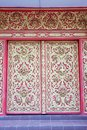 Thai style molding art at the door in the temple Stock Images