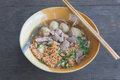 Thai style pork noodle on wood table simple food normally found in thailand and some countries in asean Stock Photo
