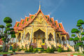 Thai style royal temple thammachak symbol in buddha stay in front of on blue Stock Photo
