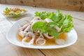 Thai style salad seafood on the wood table