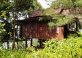 Thai style wooden house in the hills Stock Photo