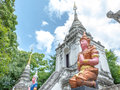 Thai temple sculpture have orange color with blue sky Royalty Free Stock Image