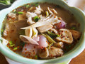 Thai tom yum soup with pork and mushroom Stock Photo