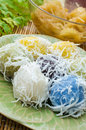 Thai traditional dessert for rituals and eating flour stuffed with sweet coconut and grated coconut topping on plate Stock Images