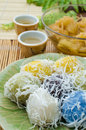 Thai traditional dessert for rituals and eating flour stuffed with sweet coconut and grated coconut topping on plate Royalty Free Stock Images