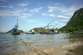 Thai traditional fishing boats lying at the beach and ready to go out at Prachuapkhirikhan ,Thailand Royalty Free Stock Photo