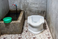 Thai traditional old toilet at home Stock Photos