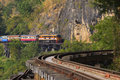 Thai trains running on death railways crossing kwai river in kan Royalty Free Stock Photo