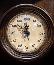 Thai vintage wooden clock pointing at eight minutes before midnight Stock Photo