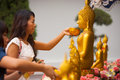 Thai Woman Bathing Buddha Statue Stock Image