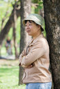 Thai woman in brown shirt and hat Royalty Free Stock Photography