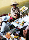 Thai woman cooking damnoen saduak floating market thailand Stock Photo