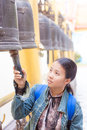 Thai woman hit the bell in temple Stock Image
