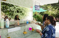 Thai woman and old women cleaning and makeup at washstand in pub Royalty Free Stock Photo