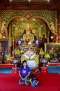 Thai woman praying golden buddha at wat ming mueang muang is located the corner of trairat road intersected with banpha prakan Stock Photos