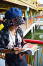 Thai woman reading guide book at Botahtaung Pagoda i Royalty Free Stock Photo
