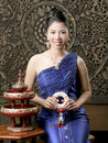 Thai woman in silk dress Stock Photo