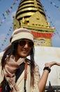 Thai woman in swayambhunath temple or monkey temple people of nepali and traveler go to for pray with wisdom eyes kathmandu nepal Royalty Free Stock Image