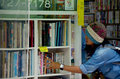 Thai women select and buy second hand book at nara bookstore on july in japan Royalty Free Stock Photos