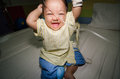 Thailand baby have sick thai girl but very happy in the dark room Royalty Free Stock Images