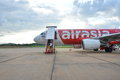 Thailand domestic plane of air asia waiting to fly on landing field loei june Royalty Free Stock Images