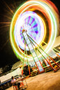 Thailand ferris wheel night motion blur colourful Stock Images