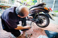 Thailand man mechanic motorcycle working bangkok Royalty Free Stock Photo
