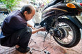 Thailand man mechanic motorcycle working bangkok Royalty Free Stock Photography