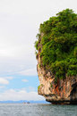 Thailand rock formation in sea scenic view of green trees on tall Stock Photography