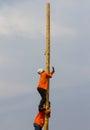 Thailand s men climb the slippery pole to a wet race prizes Royalty Free Stock Photos
