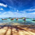 Thailand tropical beach exotic landscape with wooden boats Royalty Free Stock Photo