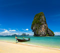 Thailand tropical vacation concept background long tail boat tropical beach limestone rock krabi thailand Stock Photos