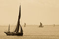 Thames barges in sepia sailing on the estuary Stock Photos