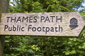 Thames footpath marker wooden sign for the path a public in rural england with the acorn designation Royalty Free Stock Photos
