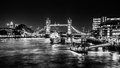 Thames noir inspired by some film i have been watching this is my take on tower bridge hms belfast and canary wharf in the Royalty Free Stock Photography