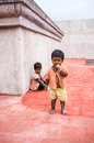 Thanjavur india february the children a boy and a girl o unidentified on roof of temple in poverty in Royalty Free Stock Photography
