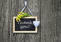 Thank you chalkboard heart and cowslips with lettering Royalty Free Stock Photography