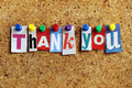 Thank you from cutout newspaper headlines pinned to a cork bulletin board Royalty Free Stock Images