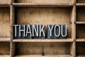 Thank you letterpress type in drawer the words written vintage metal sitting a wooden Stock Images
