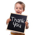 Thank you sign child holding a standing against white background Royalty Free Stock Image