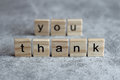 Thank you word written on wood cube
