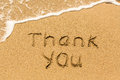 Thank you - written manually on the texture of sea sand Royalty Free Stock Photo