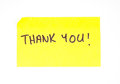 Thank you written on a sticky note yellow Stock Photos