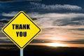 Thank you yellow road sign with clouds and sky in background Stock Photos