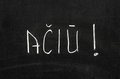 Thanks lithuanian language written on the blackboard Royalty Free Stock Photography
