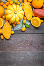 Thanksgiving Autumn Background, Variety of Orange Fruits and Vegetables on Dark Wooden Background with Free Space for Text