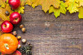 Thanksgiving autumn fall background with pumpkin, leaves, apples and nuts Royalty Free Stock Photo